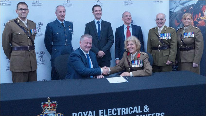Frank Mitchell, CEO SP Energy Networks, signs Armed Forces Covenant