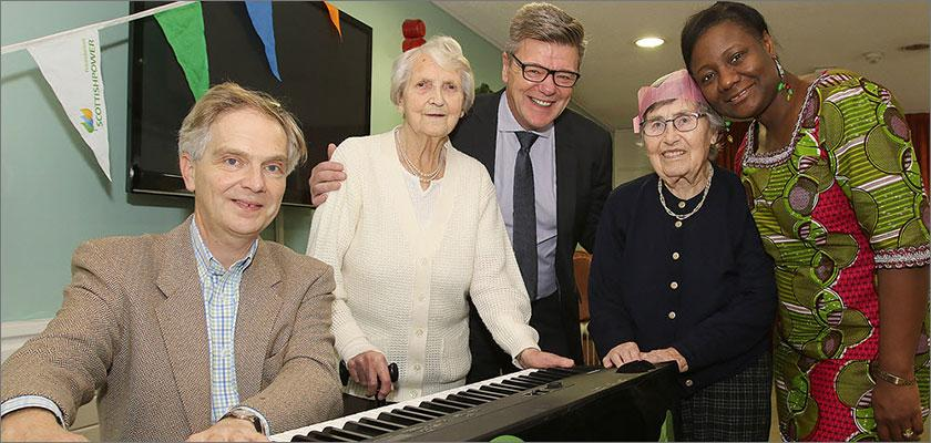 Music in Hospitals and ScottishPower Foundation bring seasonal live music to elderly residents at Park Day Centre in Newtown